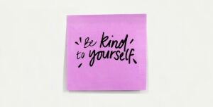 Post it note that reads Be kind to yourself