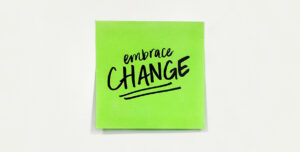 Post it note that reads Embrace change