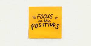 Post it note that reads focus on the positives