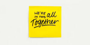 Post it note that reads we're all in this together