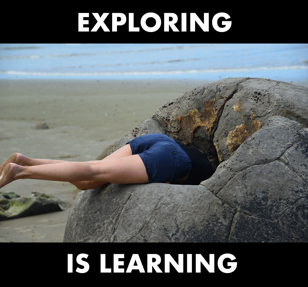person with their head inside a rock formation with the words 'exploring is learning' superimposed